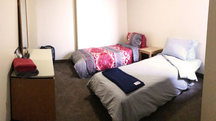 image of two single beds in an apartment bedroom