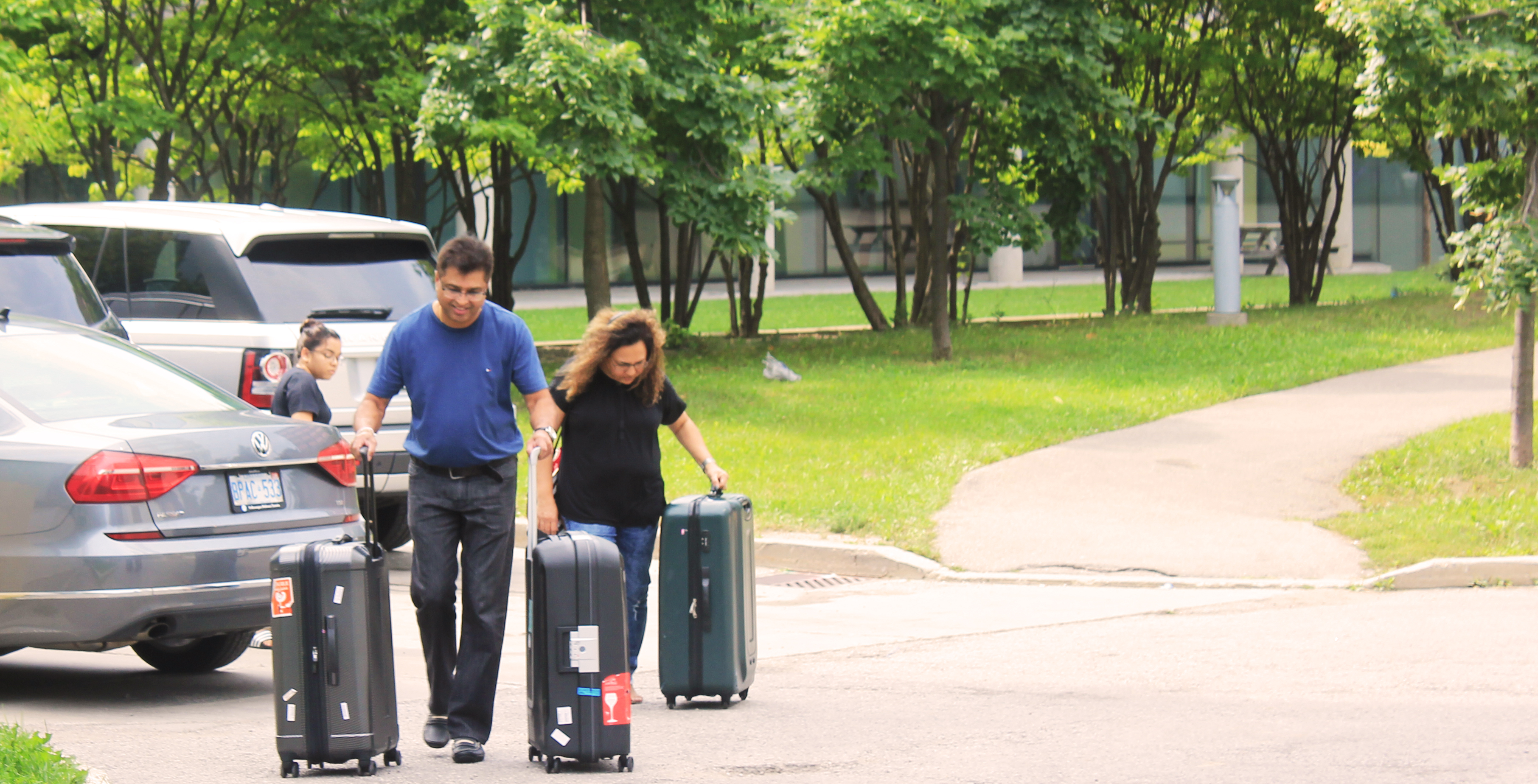 parents carrying out luggage